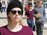 Dressed down Emma Roberts and fiance Evan Peters fuel up with take-out before embarking on furniture shopping spree