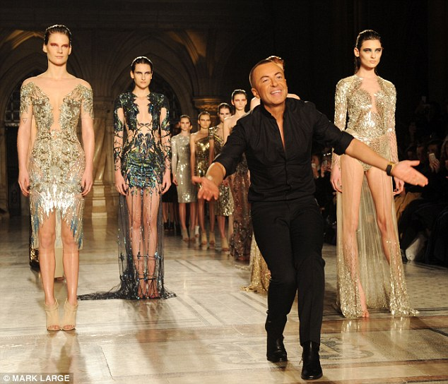 The main man: Julien appeared on the catwalk to a rapturous applause at the end of his showcase
