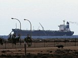 Homecoming: North Korean-flagged tanker the Morning Glory, pictured here on March 8 docked at the Es Sider export terminal in Ras Lanuf, was returned to Libya Saturday by the U.S. Navy, which had seized it last week