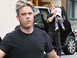 He's got his little Angel! Robbie Williams carries his adorable daughter Theodora Rose to the car after afternoon together