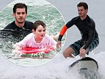 Friendly neighbourhood surfer-man! Spider-Man star Andrew Garfield takes some time to teach Autistic children how to surf