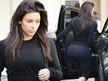Wedding prep? Kim Kardashian emerges fresh-faced and flawless from cosmetic laser clinic in figure-hugging gym clothes as her big day nears