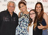 All in the family! Eva Mendes brings along her own personal cheer squad as she celebrates the launch of her New York & Company spring line