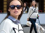 Hipster chic: Olivia Wilde sported a white sweater featuring a pair of glasses and a moustache on the front as she walked her dog Paco along with friends in West Village in New York City