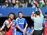 Mistaken identity: Gibbs (left) is shown a red card despite Alex Oxlade-Chamberlain's handball