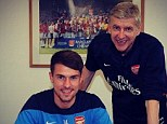 All smiles: Ramsey posted this picture of himself signing his new contract with Wenger on Instagram