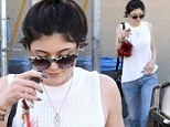 Kylie Jenner shows off her edgy style in ripped jeans as she steps out solo for day of pampering at the nail salon