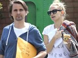 Kate Hudson and fiance Matt Bellamy put on a united front as they hit the beach together for the second day in a row