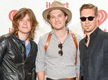 Dad of three: Zac, Taylor and Isaac, right, who has just welcomed baby daughter Nina Odette