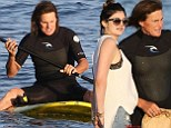 Daddy's little girl! Kylie Jenner runs her father Bruce a packed lunch after he struggles to master the sport of paddleboarding