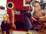 Pushing yourself? Snooki Instagarmmed an image of her playing with her one-year-old son Lorenzo's toy bench press set on Friday, after enjoying a healthy breakfast with her '2 studs'