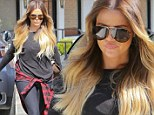 'Blonde b****y babe!' Khloe Kardashian reveals bleached waist-length locks after hitting the gym in figure-hugging leggings