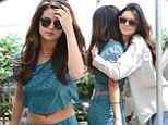BFF alert! Selena Gomez flashes toned midriff while Kendall Jenner dresses down for lunch date in double denim