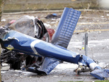 FILE - The wreckage of a news helicopter sits on a city street after crashing in this March 18, 2014 file photo taken in Seattle. The surveillance footage ta...