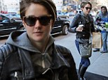 She'll drink to that! Shailene Woodley shows off her edge in leather jacket and knee high boots ... as Divergent opens in theaters
