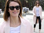 Pretty in pink: Mandy Moore emerged from the Andy LeCompte Salon in West Hollywood on Friday, rocking an oversized powder pink overcoat