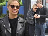 Blackhearts club: Lara Bingle and Sam Worthington stick close together out in LA on Friday