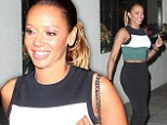 Still got it! Mother-of-three Mel B bares her midriff in cropped top on romantic dinner date with husband Stephen Belafonte
