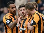 Former Baggie: Shane Long (centre) is congratulated by his Hull team-mates after scoring against his old club