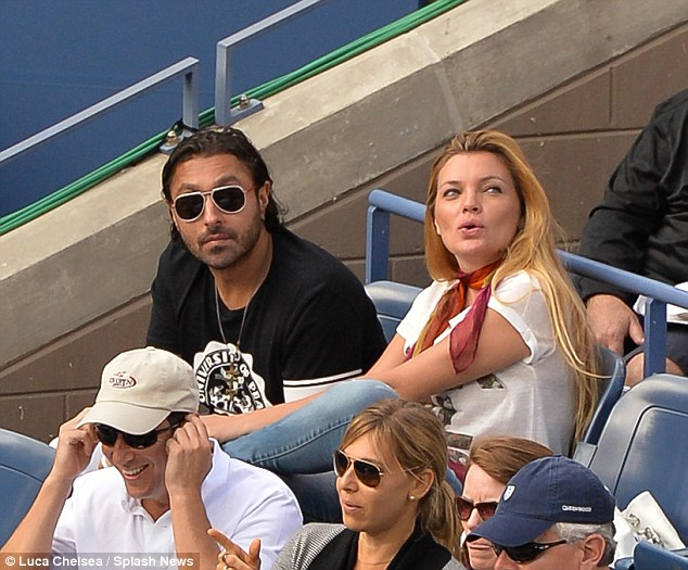 Messy: Vikram Chatwal and Esther Canadas - seen here together at the 2013 US Open - will have their break-up aired in court after Chatwal filed a lawsuit against his former bride-to-be in order to get his engagement ring back
