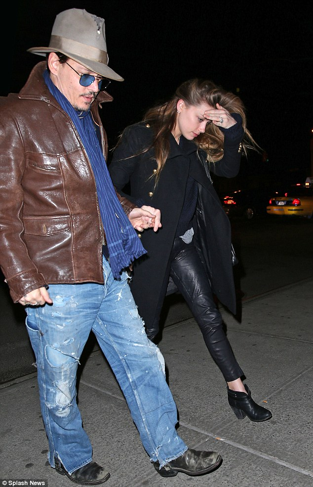 Love: The 27-year-old actress could not hide her smile as she walked beside Johnny