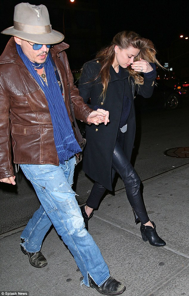 NOT shy! Amber flashed her enormous engagement ring during the nighttime stroll