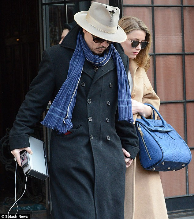 Blue: The engaged couple wore matching splashes of blue with their outfits