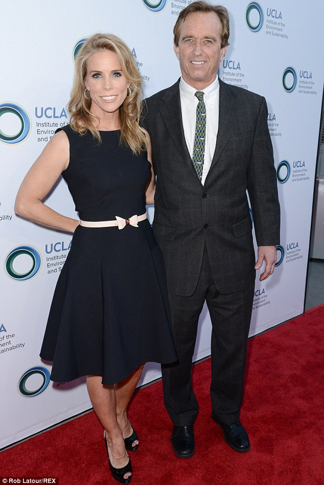 Bow-tiful: Cheryl Hines wore an A-line black dress with a cute pink bow belt, as Robert Kennedy dressed in a charcoal suit