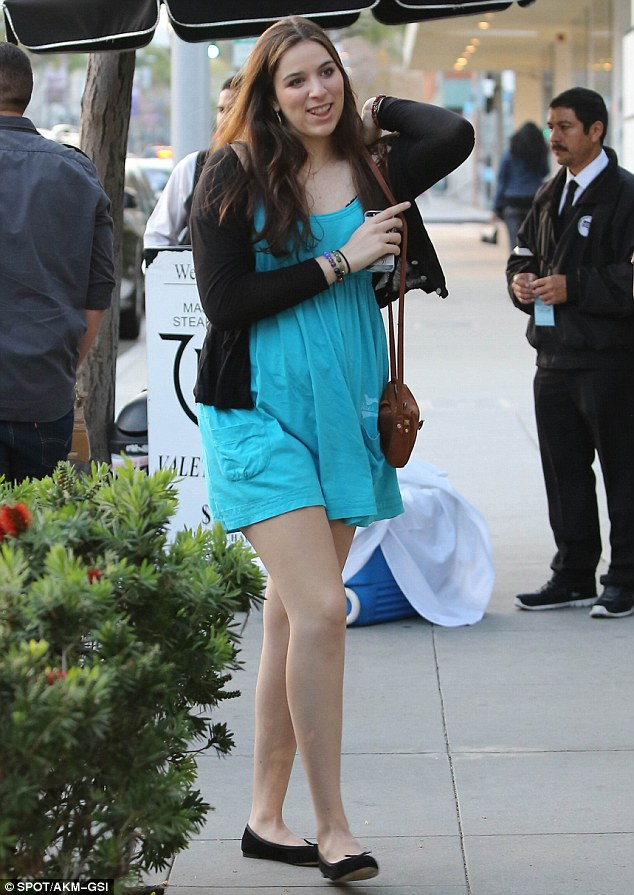 Summery look: The couple's female friend also headed out for dinner with them in Beverly Hills