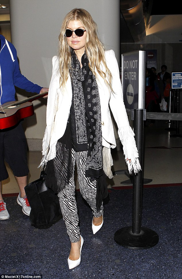 Fergalicious: Fergie returned from Washington D.C. and arrived at LAX on Friday dressed in a flashy black and white ensemble