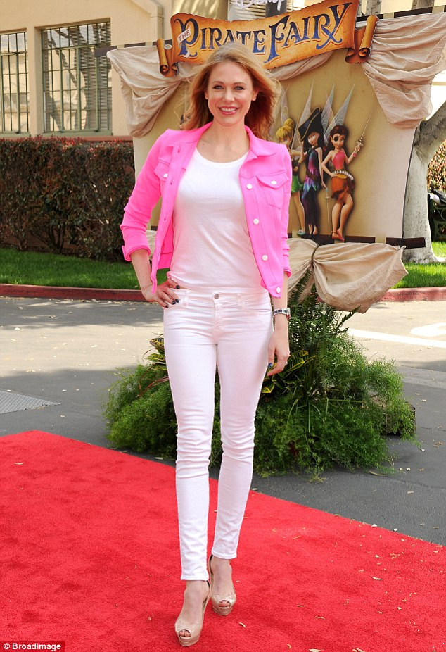 Leggy lady: White Chicks star Maitland Ward showed off her long lean legs in a pair of pale trousers, teamed with a shirt in the same shade, and a bubble gum pink jacket