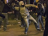 Protesters have clashed with riot police in Madrid throwing bottles and bricks, leaving six officers injured