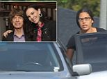 Mick Jagger's eldest daughter Karis has emerged from the house where her bereaved father is believed to be staying as he plans the Los Angeles funeral for L'Wren Scott.