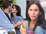 Sneaky smooch: Courteney Cox and Johnny McDaid enjoyed a kiss on the lips in Los Angeles on Thursday
