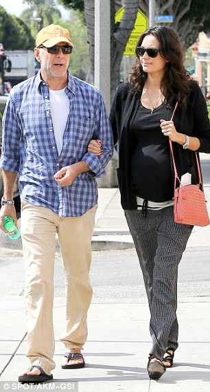 Nothing fancy: Despite to being a big day, the casually dressed couple looked relaxed as they walked through the beach suburb, holding hands as they did