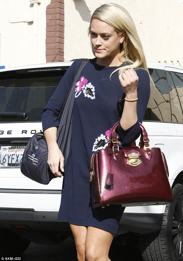 Fancy cargo: The 27-year-old professional dancer carried a shiny maroon Louis Vuitton purse