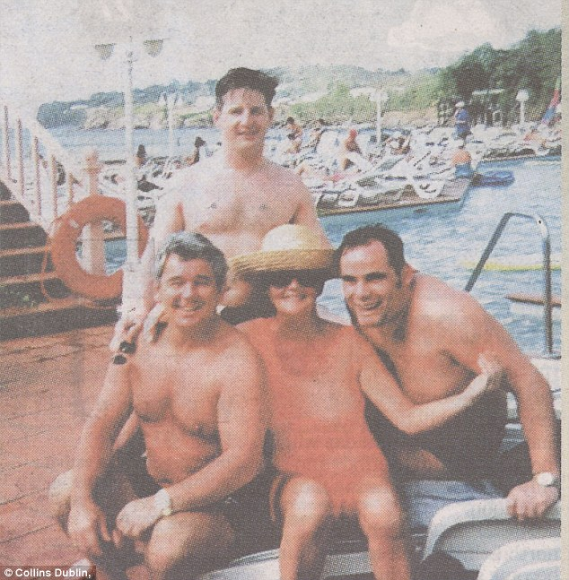 Relaxing: John Gilligan (bottom left) with wife Geraldine (centre), Brian Meehan (standing) and suspected gang member Peter Mitchell (also known as 'Fatso' Mitchell') on holiday in St Lucia