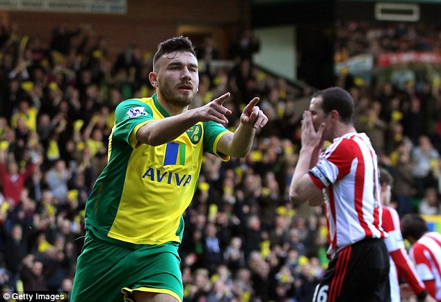 Support act: Robert Snodgrass points to Johan Elmander after being set up for the opening goal