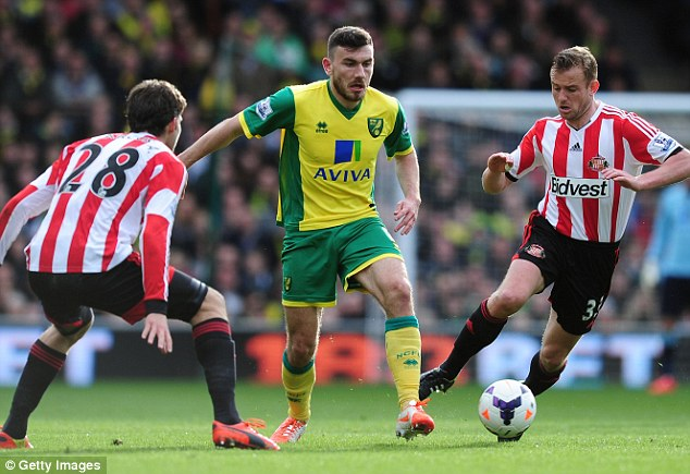 Stuck in the middle:  Robert Snodgrass (C) battles with Sunderland's Marcos Alonso (L) and Lee Cattermole
