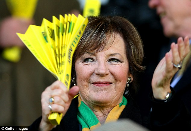 Let's be 'aving yer! Celebrity chef and joint majority shareholder Delia Smith watches from the stands