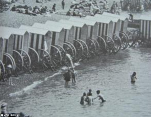 Bathing machines during the 1800s. In this picture you can see the wide berth given to the bathing machines by other beach goers, as a part of the strict rules