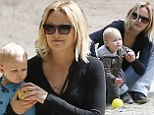 Come slide with me! Malin Akerman dotes on son Sebastian while playing at jungle gym in practical and comfortable apparel