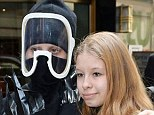You met who? A fan poses with a nearly unrecognisable Lady Gaga, who is wearing head-to-toe black complete with a ski mask