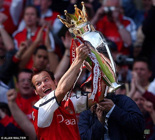 Champion: Ljungberg holds the Premier League trophy aloft at the end of the 2001-02 season