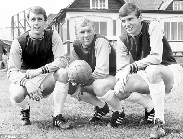 Winners: Hurst with West Ham team-mates Moore and Martin Peters shortly after the World Cup success