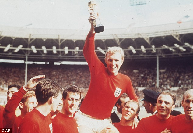 Back then: Hurst lifts West Ham team-mate Bobby Moore as the World Cup is held aloft in 1966