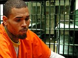 'I feel like a caged animal!' Chris Brown 'is scared straight in jail as he pursues civil settlement to avoid prison'