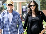 Big day, small celebration! Bruce Willis and his very pregnant wife Emma Heming mark their fifth wedding anniversary with a stroll in the sunshine