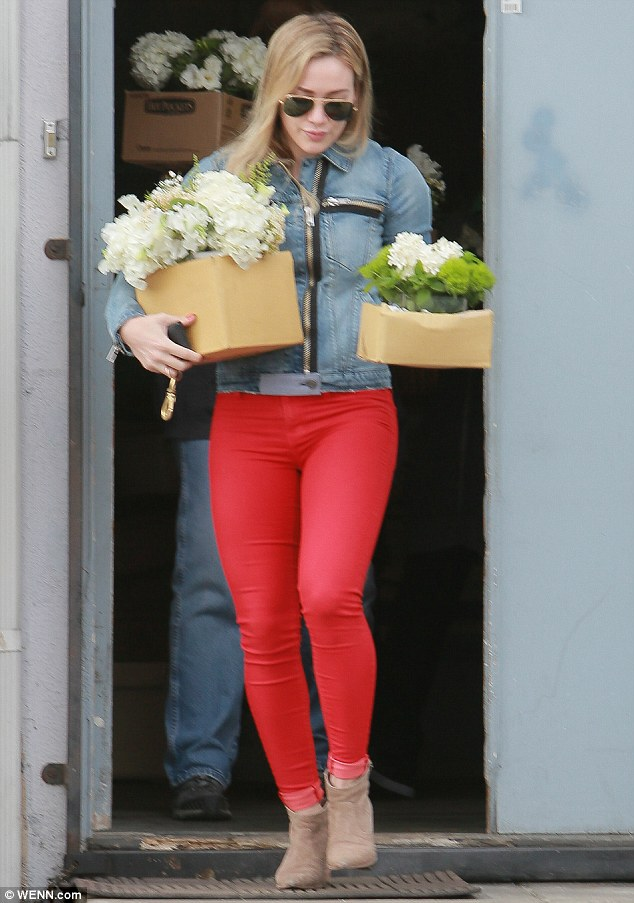 Edgy chic: The Lizzie McGuire star teamed them with a denim jacket featuring large zippers and beige ankle boots