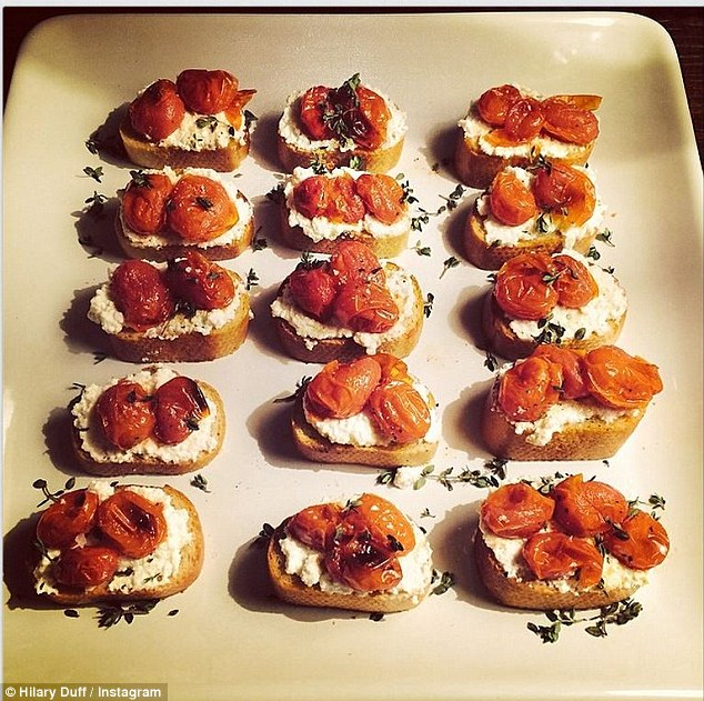 Multi talented: Hilary showed off her culinary skills as she Instagrammed this image on Friday with the caption, 'Roasted tomato, thyme and ricotta crostini I made last night'